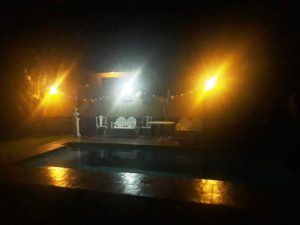 The swimming pool at night - Palm Beach Chalets