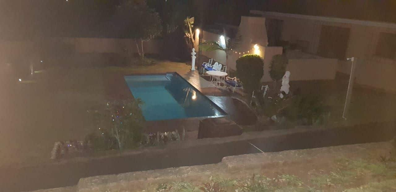 Swimming Pool at night - Palm Beach Chalets